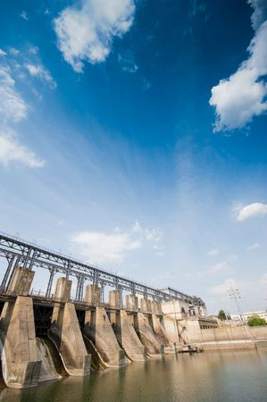 Dam, beautiful cloudscape, wide angle view  photo