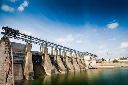 water power: Wide angle view of a dam, summertime  Stock Photo