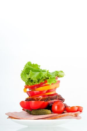 Tomatoes, ham and salad, isolated on white background Stock Photo - 5376324