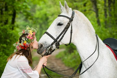 Cute girl with horse in the forest  photo