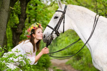 horse riding: Smiling girl with horse in the forest  Stock Photo