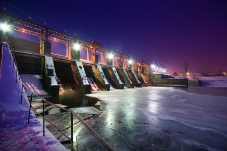 water power: Night view of a dam, winter time