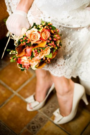 Close-up shot of bride holding bouquet, selective focus  photo