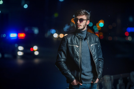 street night: Stylish young man in the lights of the city at night Stock Photo