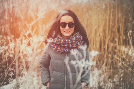 sun glasses: beautiful smiling girl wearing fashionable winter outdoors