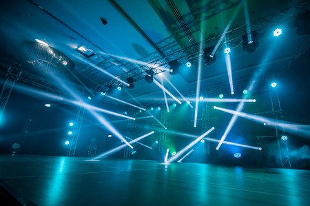 dancing at the concert,Illumination, light on the stage at the disco
