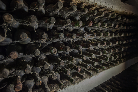Old wine bottles in a cobweb in the cellar