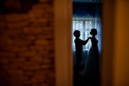 beautiful brides silhouette in the room 写真素材