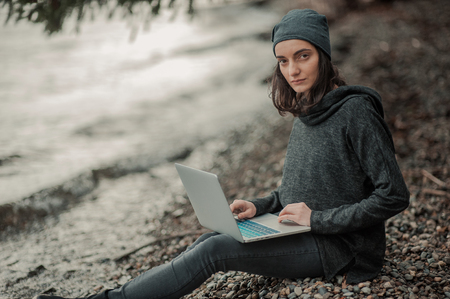 girl with a computer in nature