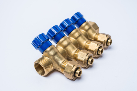 Brass tee to connect plastic pipes isolated on white background