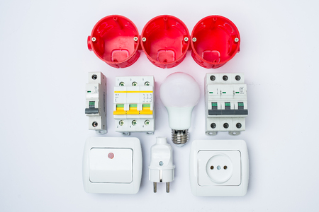 A set of electrical tools on a white background. Accessories for engineering works, energy concept.