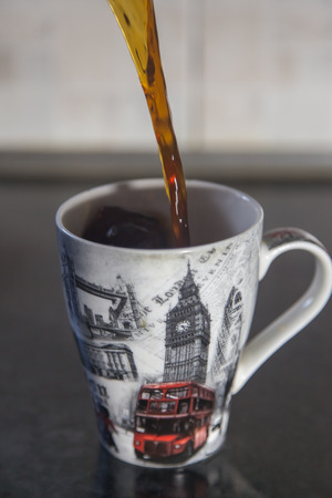Pouring coffee in white mug Stock Photo