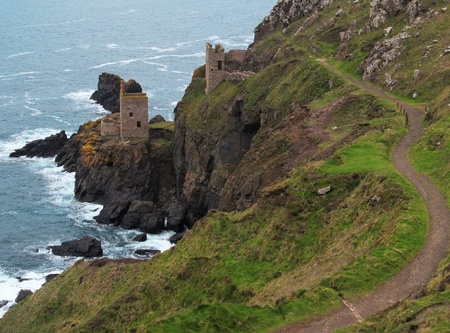 british weather: The Botallack Tin Mine ruins preserved on the cliffs above the sea in Cornwall