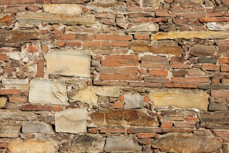 Stone and bricks in this colorful ancient church wall as a background. photo