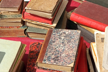 Piles of old damaged books on a table. Stock Photo - 13326815