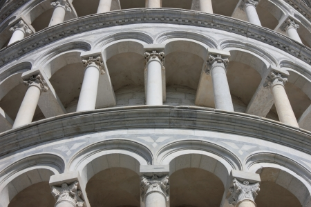 Famous Leaning Tower in Pisa detail of the marble arches on piazza dei Miracoli. photo