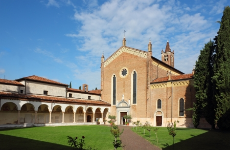 bernardino: San Bernardino church in Verona in a bright sunny day. Angle shot of the garden and the church over a clear blue sky. Stock Photo