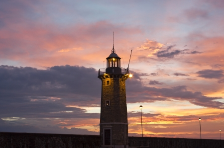 garda: Desenzano Del Garda the old Lighthouse close up shot in an early morning beautiful sunrise  Stock Photo