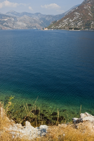monastery nature: Panoramic view ot the Bay of Kotor with the Saint George Benedictine monastery in the distance. Stock Photo