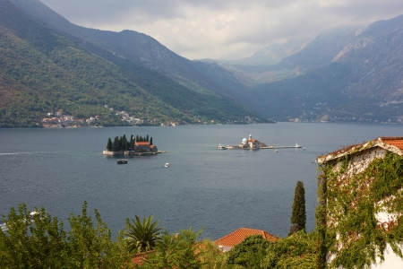 View from town of Perast toward the island with the monastery Saint George in the bay of Kotor in Montenegro. photo