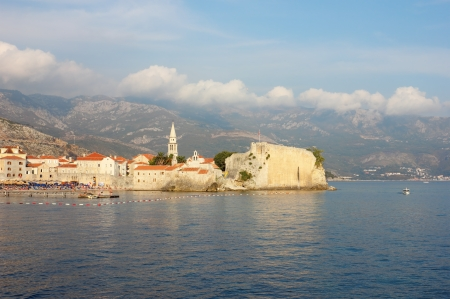 Panoramic view toward the old part of Budva in Montenegro, shot in the warm light of the late afternoon. photo