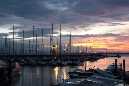 garda: Colorful sunrise at Desenzano del Garda with the Marina and the old lighthouse. Stock Photo