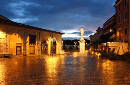 garda: View of Piazza Malvezzi in Desencano Del Garda in early morning, just before dawn.