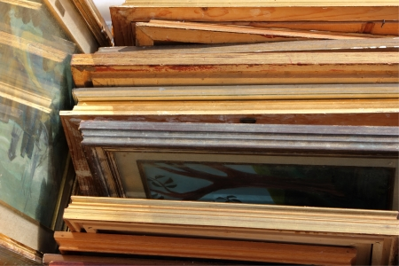A bunch of old frames with some artworks on a saturday market.  Stock Photo - 18336058