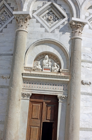 Straight shot of the leaning tower entrance door in Pisa, Italy. photo