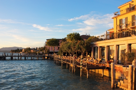 garda: Sunset view of the jetty port in Sirmione on Lago di Garda, Italy.