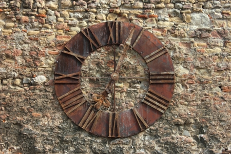 timekeeper: Ancient Clock Face in Zagreb on the wall near the cathedral.  Stock Photo