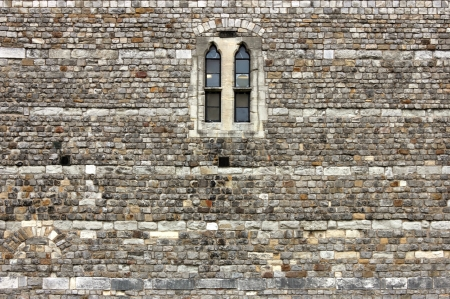 Detail with a single window from the castle wall in Windsor, Windsor Castle.