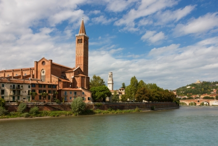 Panoramic view of Dominican church of SantAnastasia with ponte Pietra in the distance in Verona, Italy in a bright sunny summer day.