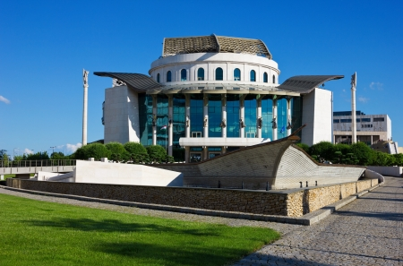 The modern building of the National theatre in Budapest Hungary over clear blue sky.