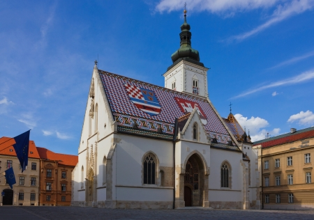 Panoramic view of Saint Mark church in upper old town in Zagreb, shot in the warm light of the sunset.
