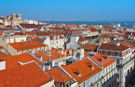 baixa: Panoramic view of Baixa district, downtown area in Lisbon, Portugal with the cathedral and river Tagus at the background