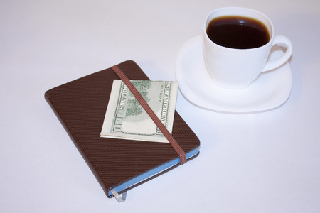 drawing up: Morning coffee and drawing up plans for the day. Stock Photo