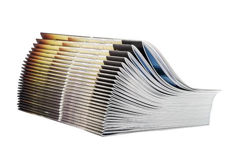 흰색 배경에 고립 된 잡지의 더미 스톡 콘텐츠