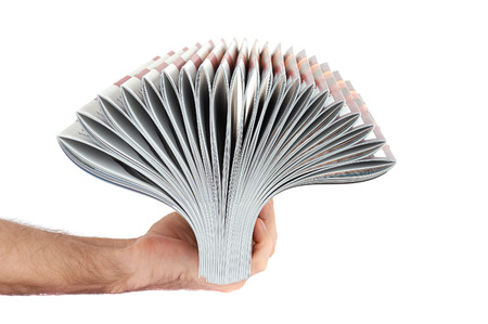Pile of magazines in hand isolated over white background Archivio Fotografico