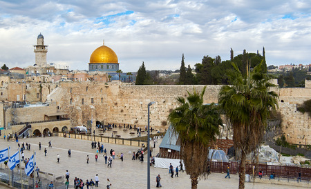 Jerusalem, Israel - February 6, 2015: Western Wall also known as Wailing Wall or Kotel in Jerusalem. People are coming to pray.