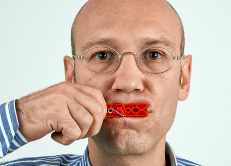 tightly: Man with mouth tightly closed with clamp
