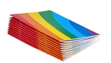 Pile of rainbow magazines isolated on white Stock Photo