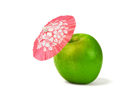 cocktail umbrella: Green Apple with drink cocktail umbrella isolated Stock Photo
