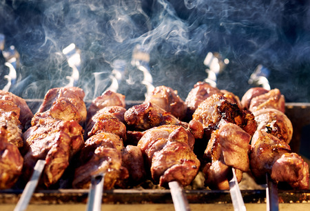 Barbecue skewers with meat on the brazier Stock Photo