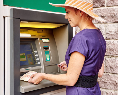 operates: Pretty woman operates an ATM on the street