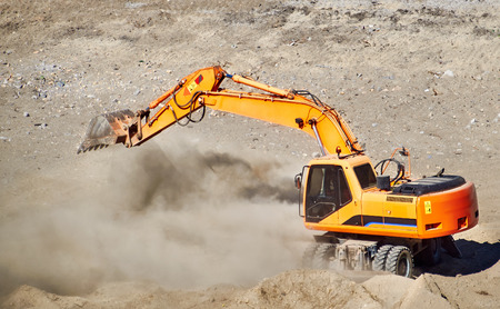 mover: Excavator bulldozer mover in action Stock Photo