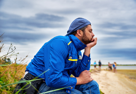 meditative: Pensive meditative man on sea background Stock Photo