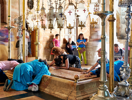 anoint: Jerusalem, Israel - June 06, 2015: Prayers at the Stone of Anointing in the Holy Sepulchre Church in Jerusalem. The Holy Sepulchre Church is the most sacred place for all Christians in the world.