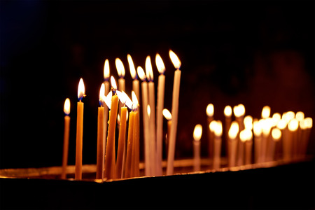 prayer candles: Candles in the Holy Sepulchre Church in Jerusalem Stock Photo