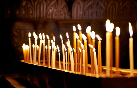 anoint: Candles in the Holy Sepulchre Church in Jerusalem Stock Photo